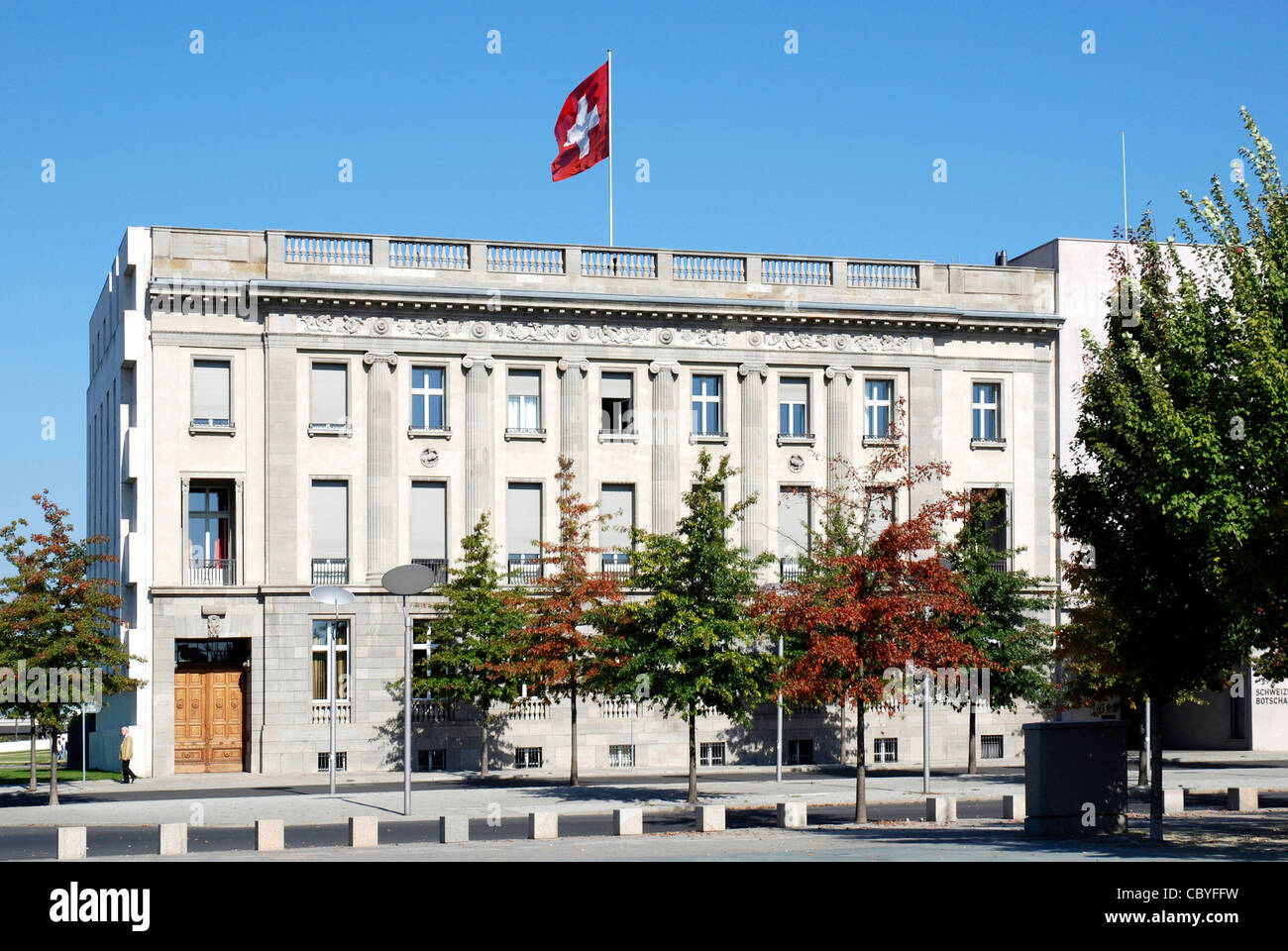 Embassy of Switzerland in Berlin with the Swiss national flag. - Stock Image
