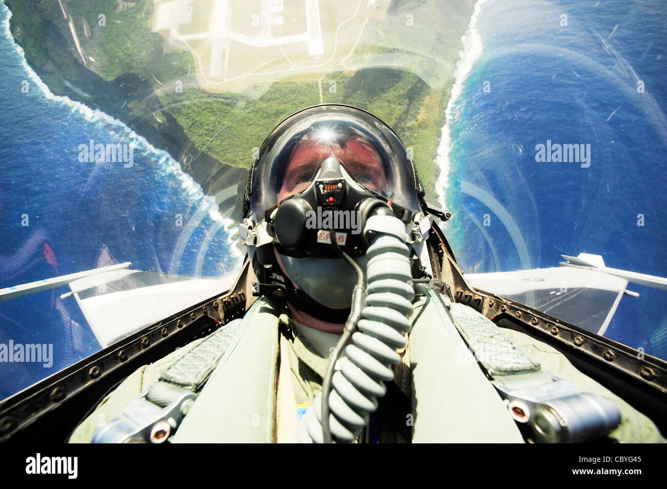 An F-16 Fighting Falcon pilot conducts an unrestricted vertical climb from Andersen Air Force Base, Guam, during - Stock Image