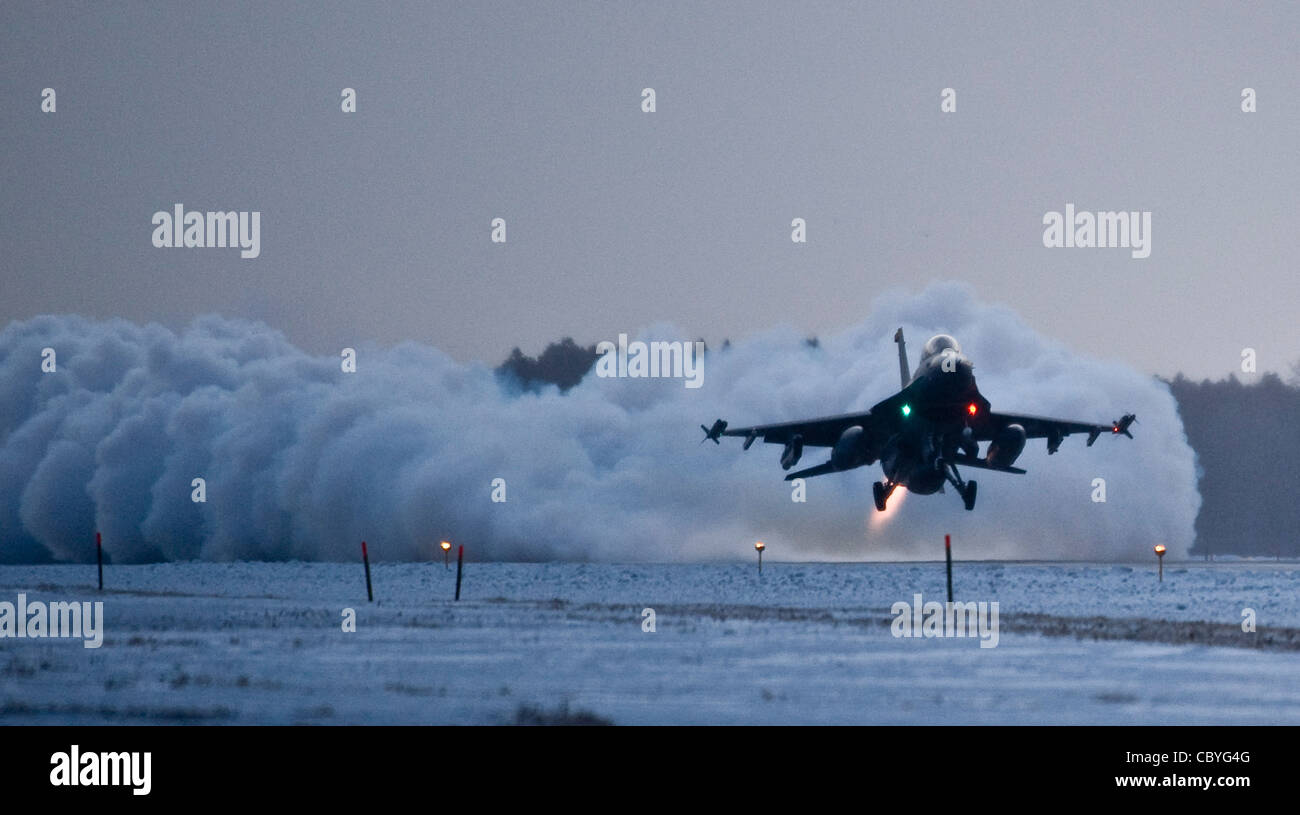 An F-16 Fighting Falcon takes off before dawn with Capt  Cory Farrer