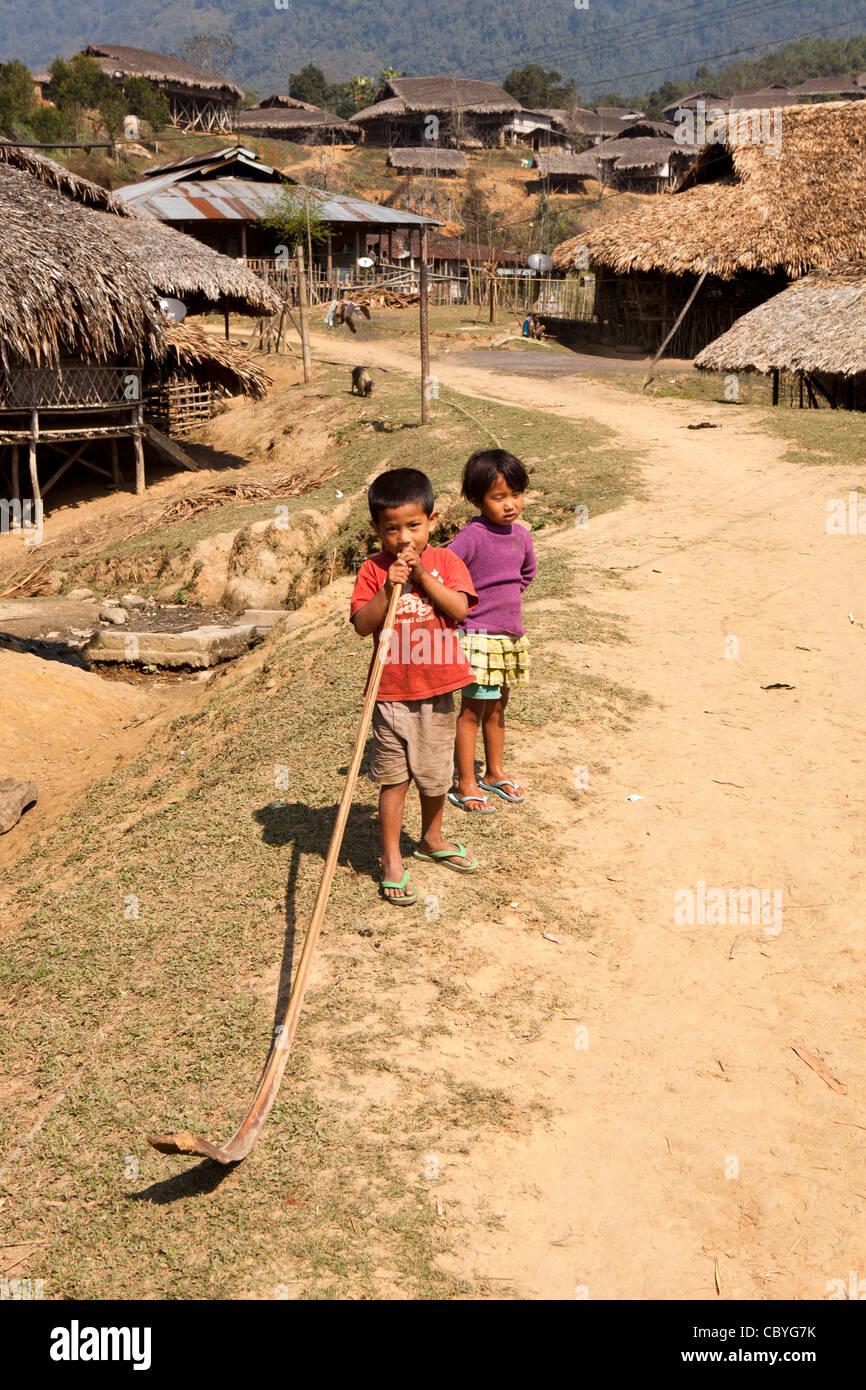 India, Arunachal Pradesh, Along, Jining village, children playing with palm leaf spine - Stock Image