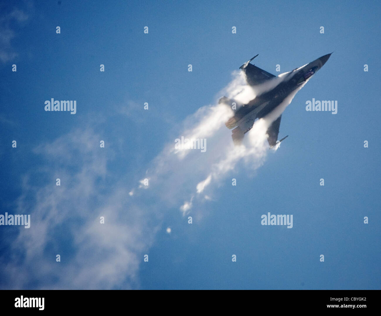 An F-16 Fighting Falcon generates vapor trails during it's high performance demonstration for AirFest 2008 at - Stock Image