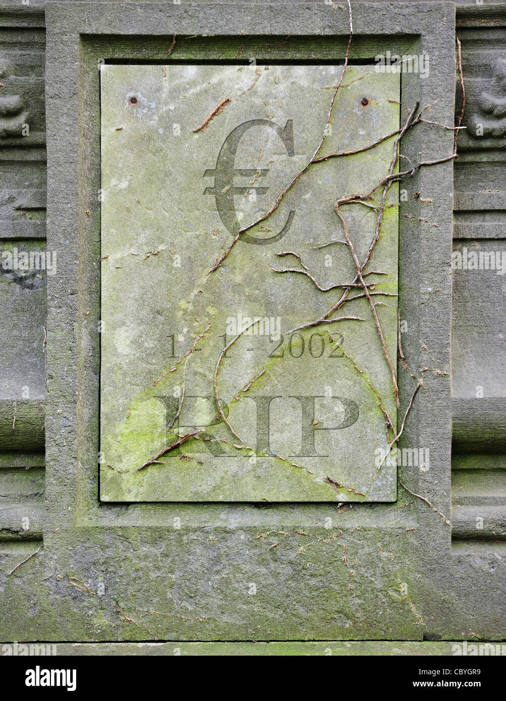Conceptual grave with € and RIP engraved for symbolic death of European euro due to financial crisis and bank debt - Stock Image