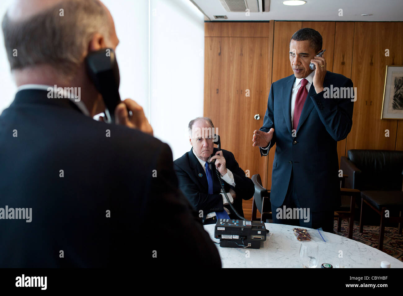 President Barack Obama takes part in a phone call briefing on Libya March 19, 2011 at the Palacio Do Planalto in - Stock Image