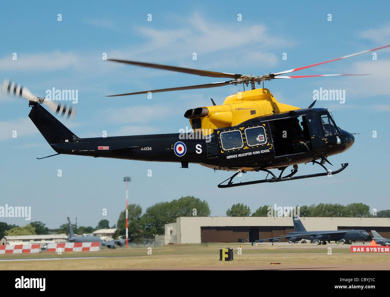 Bell 412EP Griffin HT1 helicopter of the Royal Air Force Defence Helicopter Flying School hover taxis to the runway - Stock Image