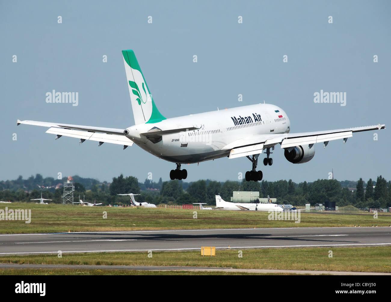 Mahan Air Airbus A300B4-600 (EP-MNR) lands at Birmingham International Airport, England. - Stock Image