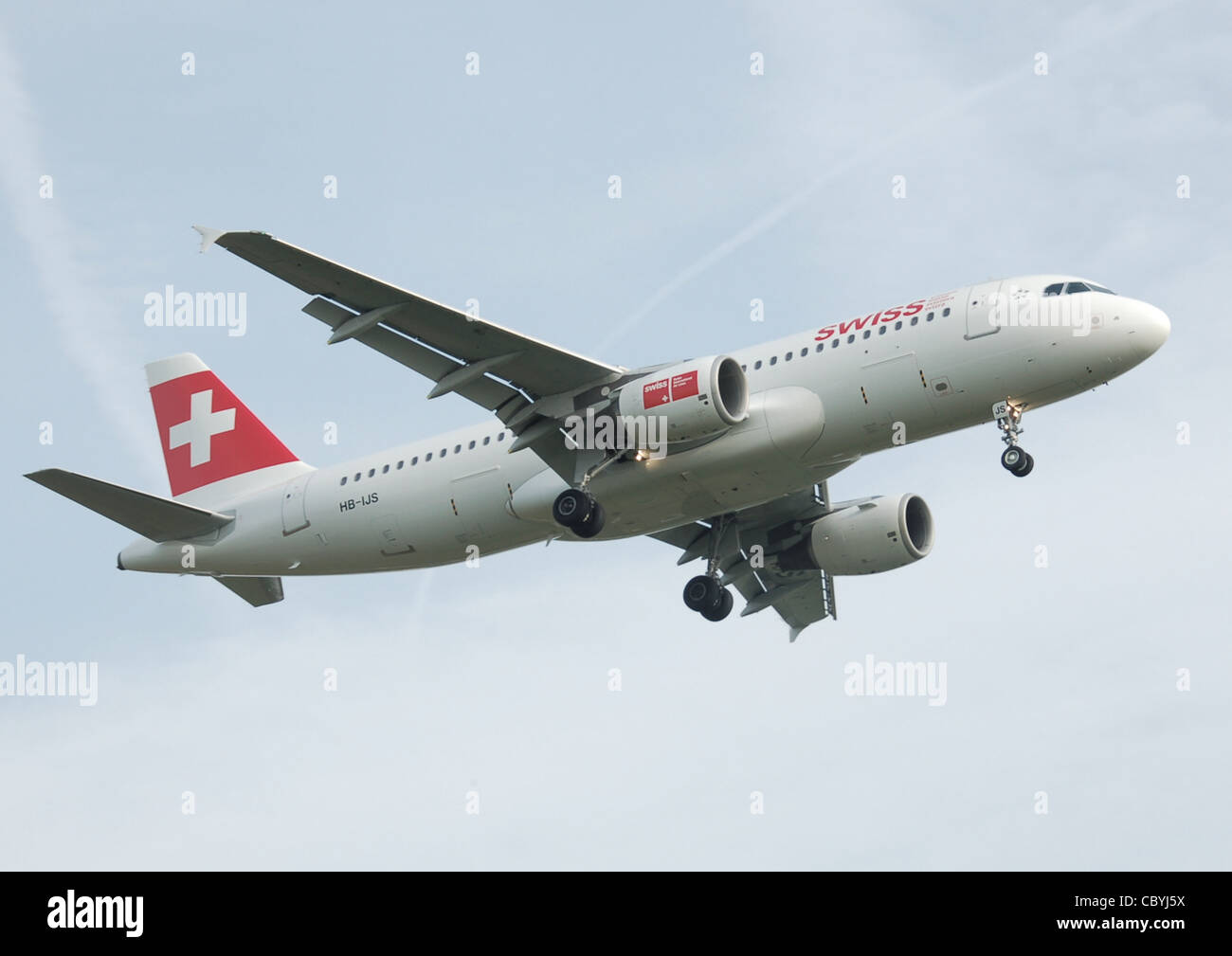 Swiss Airbus A320-200 (HB-IJS) lands at London Heathrow Airport, England. - Stock Image