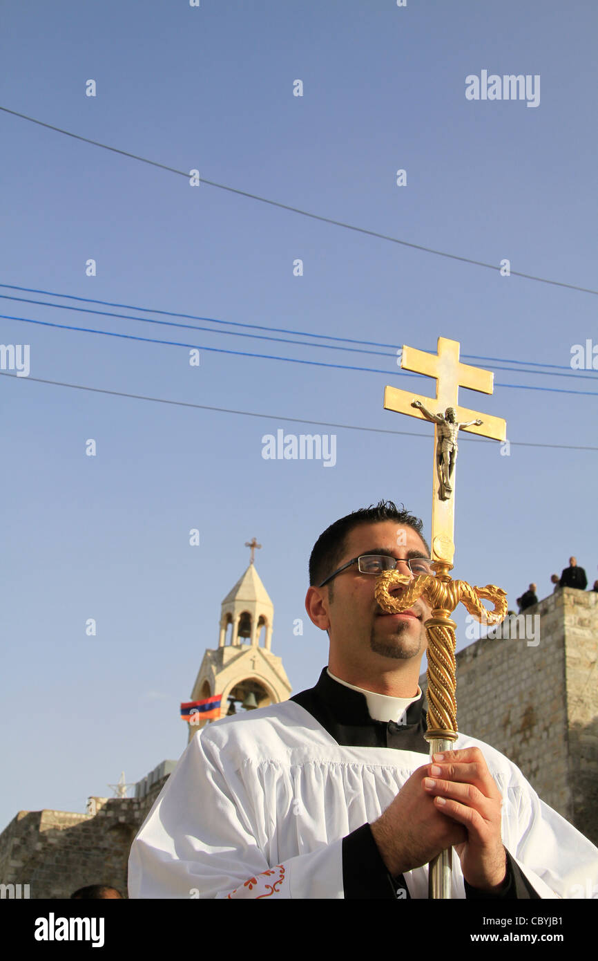 Bethlehem, the Latin Christmas Procession at Manger Square, the Church of the Nativity in the background - Stock Image