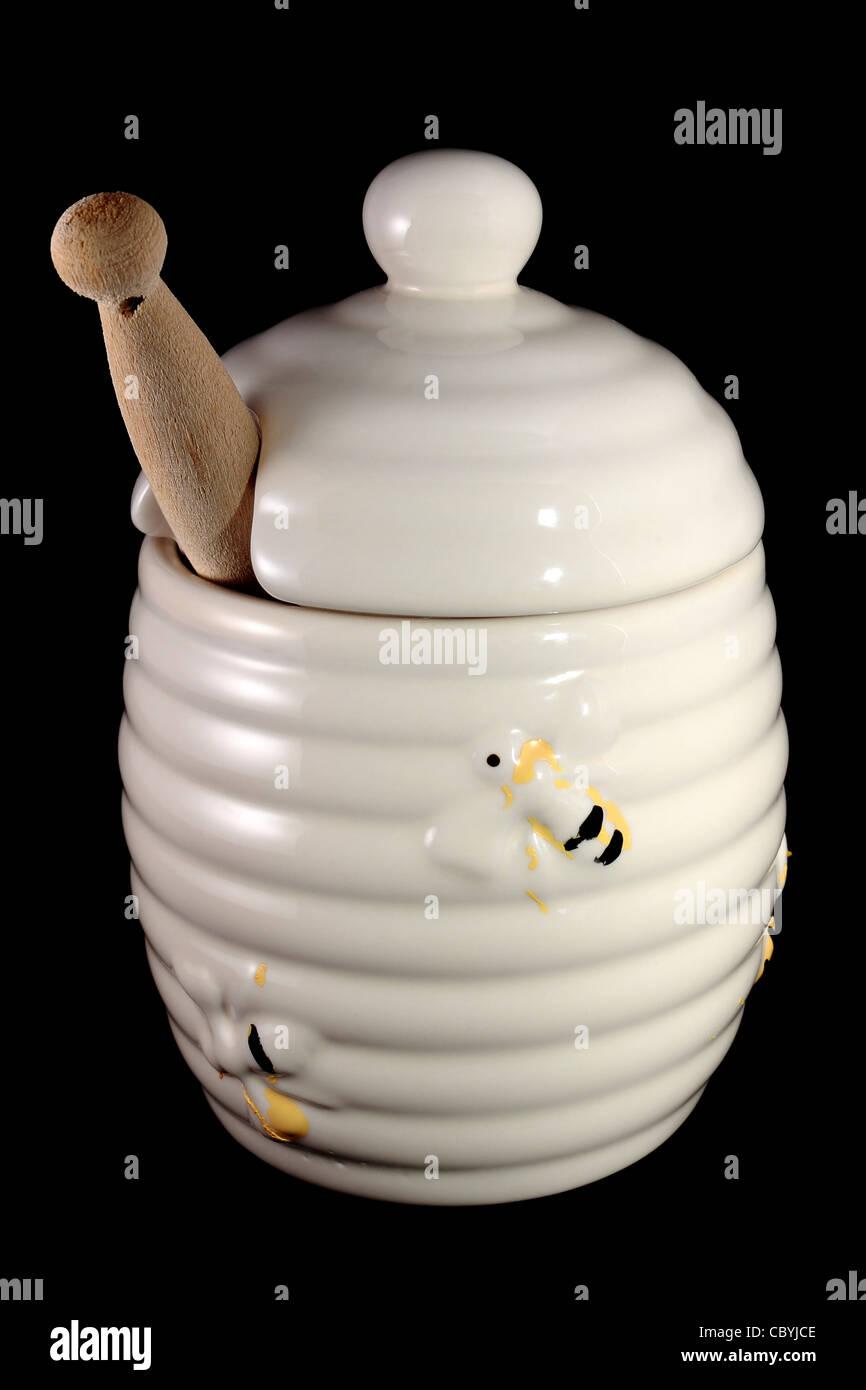 Honey Pot isolated on black background - Stock Image