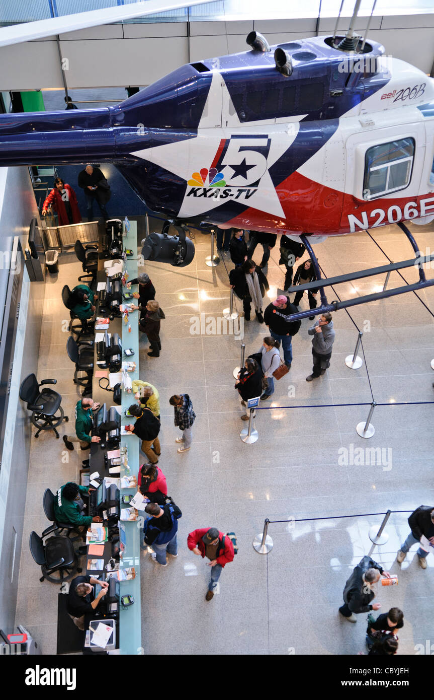 WASHINGTON DC, USA - A news helicopter is suspended above the entrance hall of the Newseum, right above the ticket - Stock Image