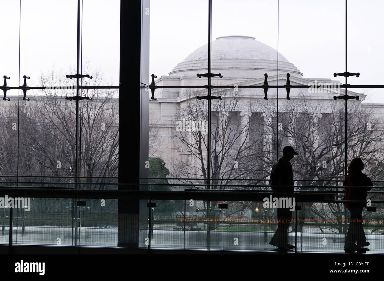WASHINGTON DC, USA - The National Gallery of Art building as seen through the glass panels of the Newseum across - Stock Image