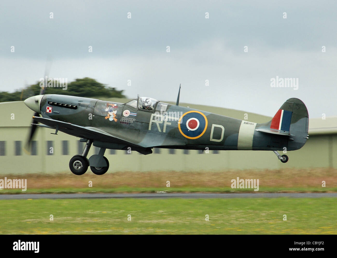 Supermarine Spitfire Mark 5b (AB910, RF-D) of the UK Battle of Britain Memorial Flight takes off from Kemble - Stock Image