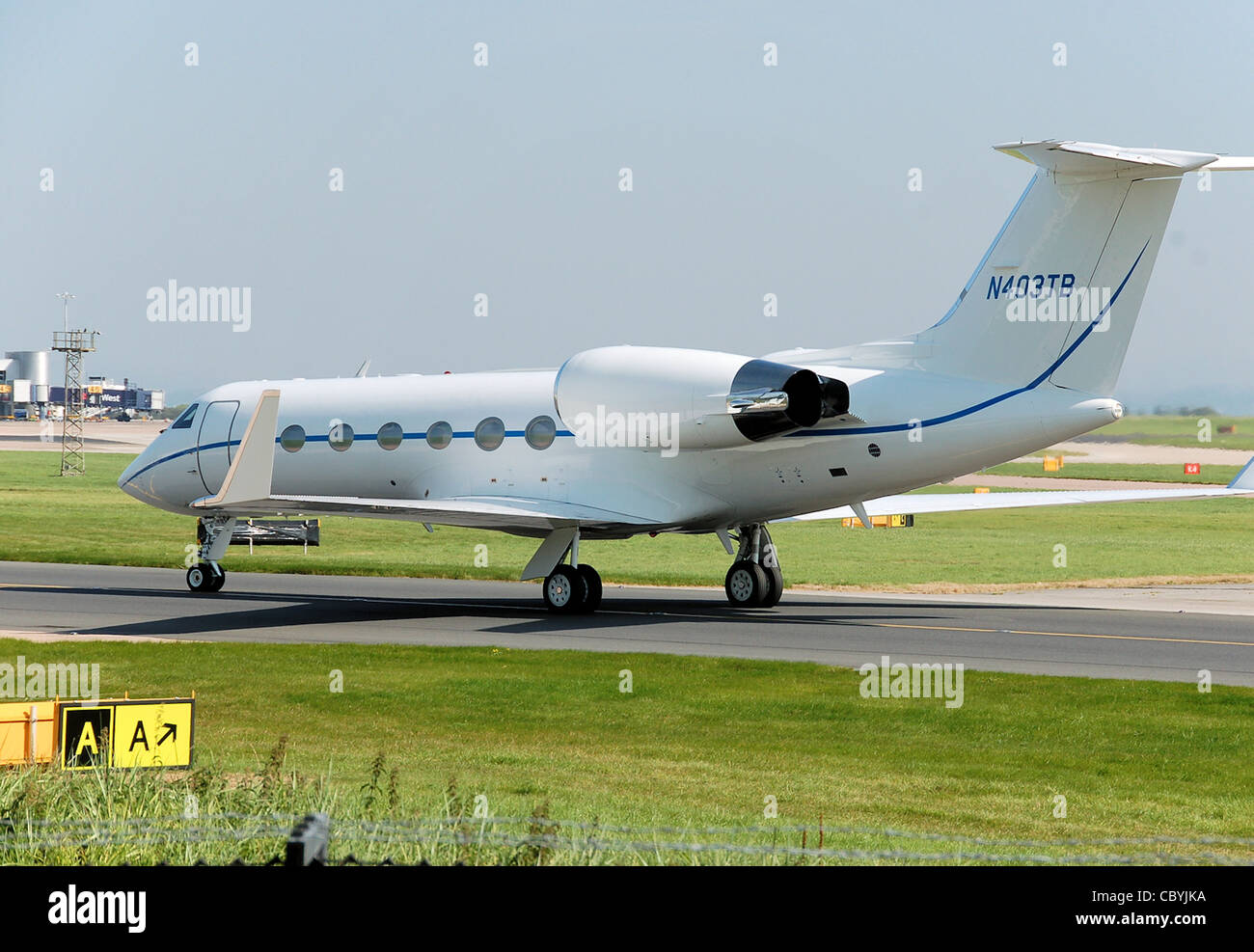 Gulfstream G-IV business jet (N403TB) taxis past the Aviation Viewing Park, after landing at Manchester Airport, - Stock Image