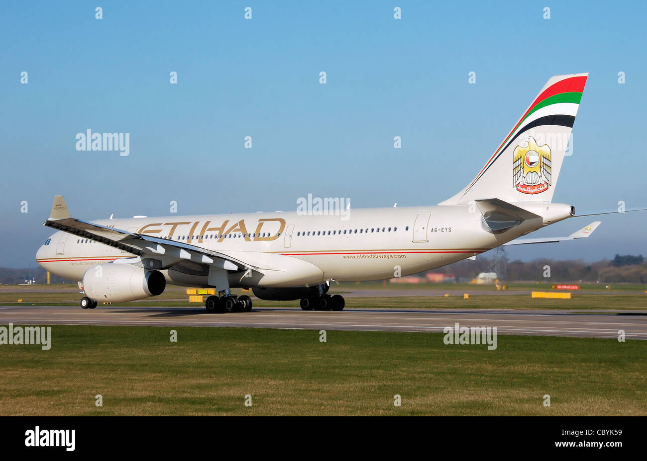 Etihad Airways Airbus A330-200 (A6-EYS) taxis for takeoff at Manchester Airport, England. - Stock Image