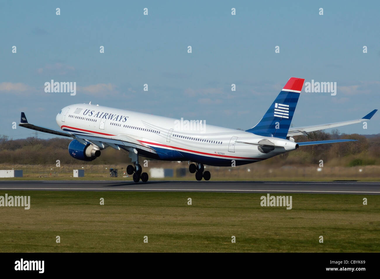 US Airways Airbus A330-300 (N278AY) takes off from Manchester Airport, England. - Stock Image