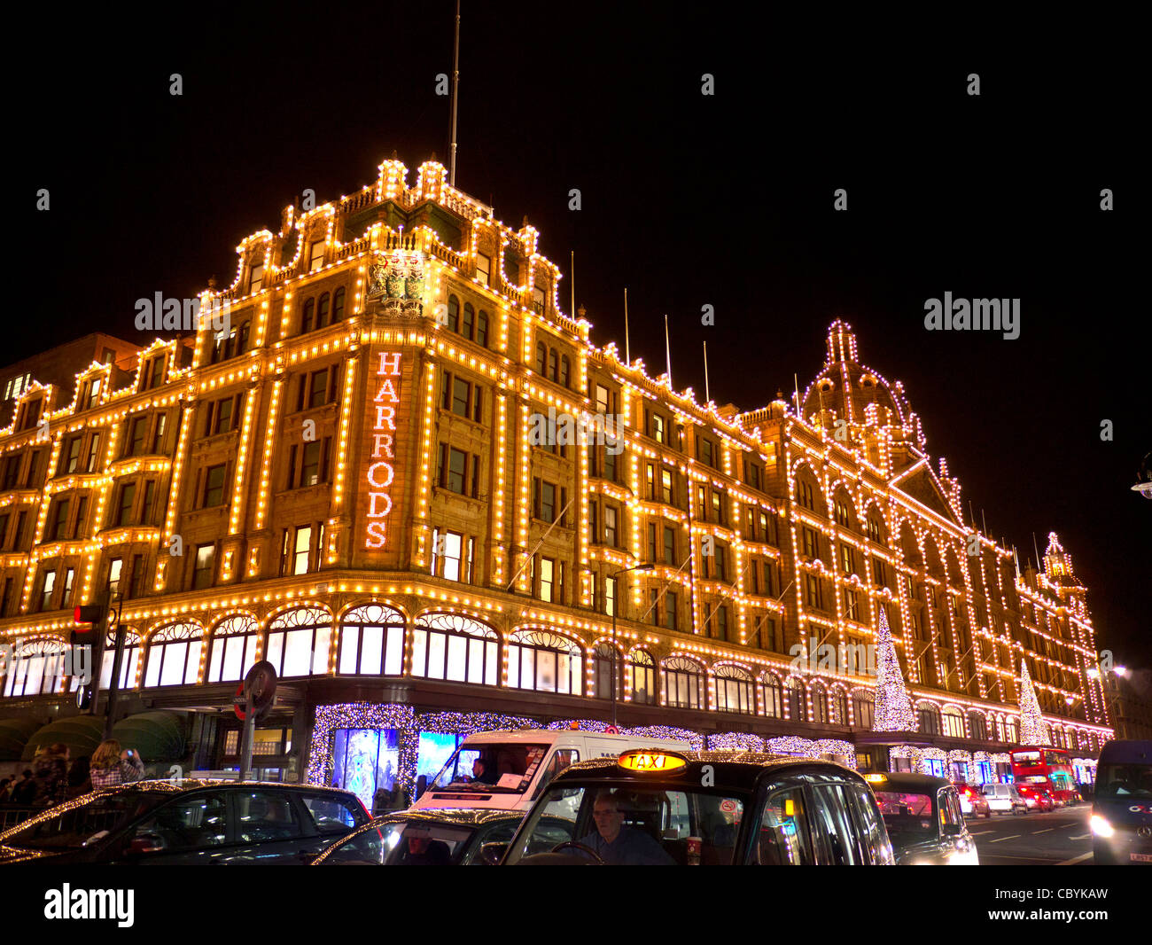 Harrods department store at dusk with Christmas lights shoppers and ...