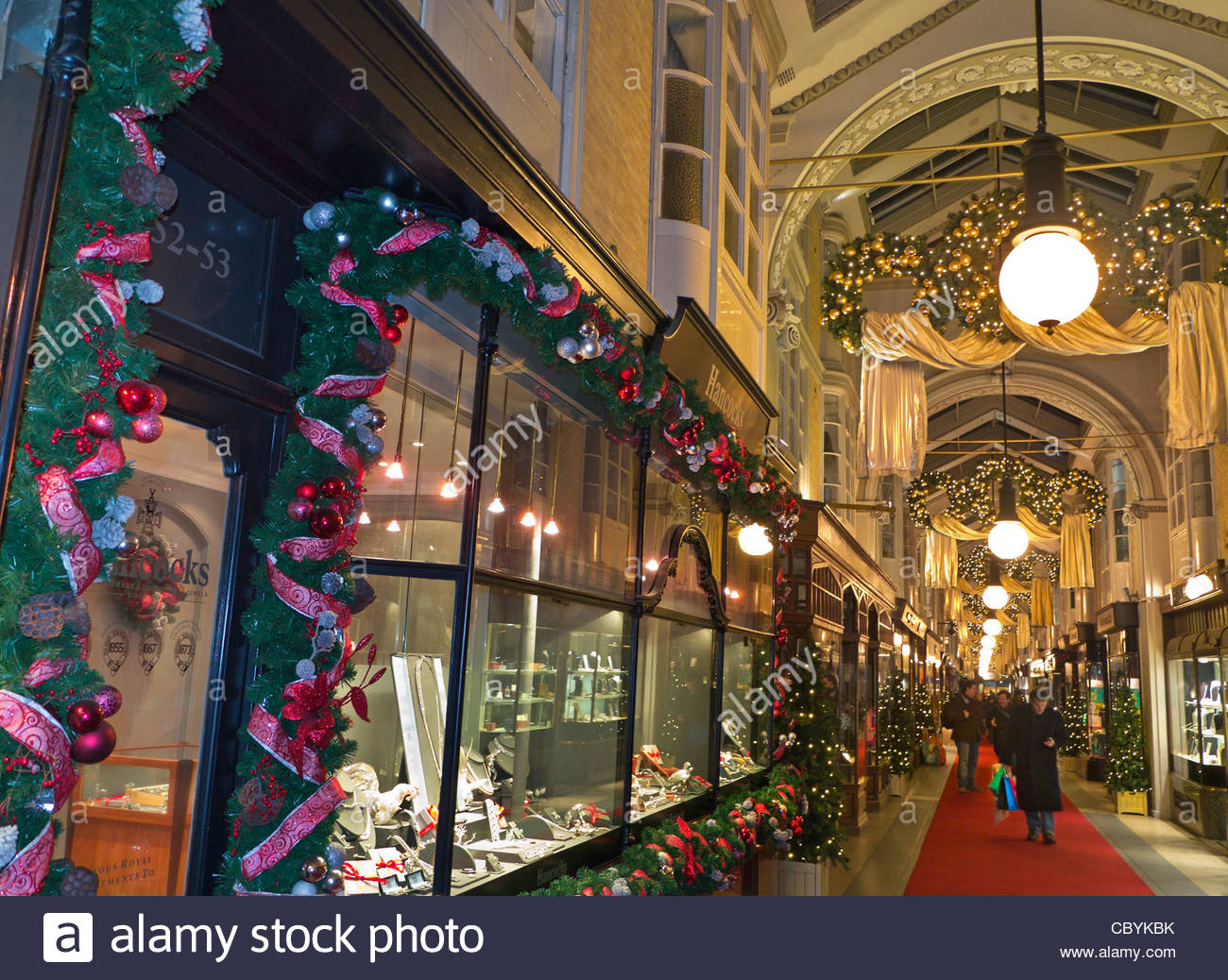 Burlington Arcade in Piccadilly with traditional Christmas decorations and shoppers London UK - Stock Image