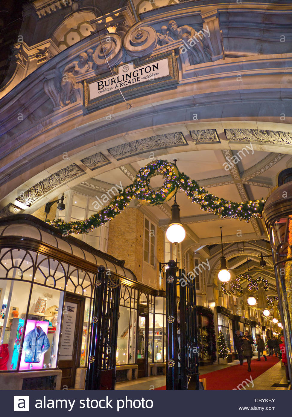 Burlington traditional luxury London shopping arcade entrance in Piccadilly with Christmas lights and decorations - Stock Image