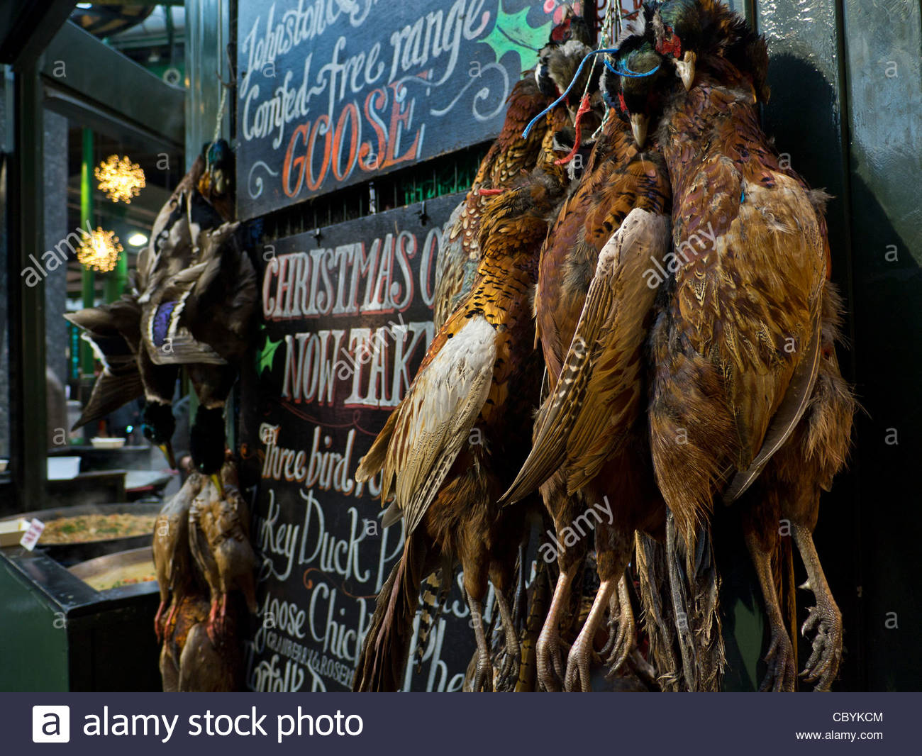 CHRISTMAS GAME BIRDS Selection of game bird hanging on display for sale at Borough Market interior Christmas stall - Stock Image
