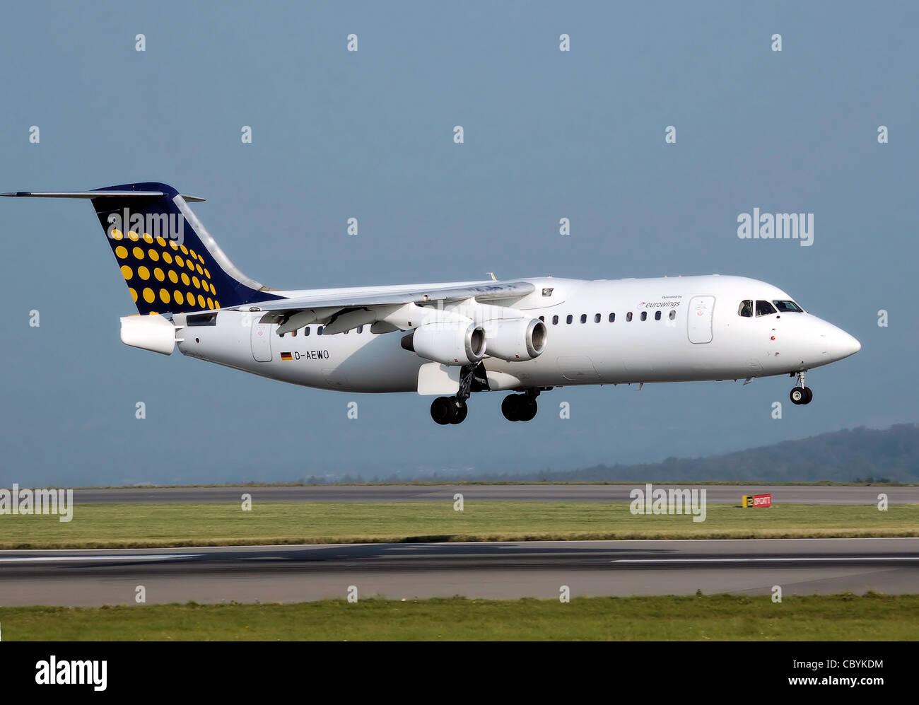 Lufthansa Regional (Eurowings) BAe 146-300 (D-AEWO) lands at Bristol International Airport, England. - Stock Image
