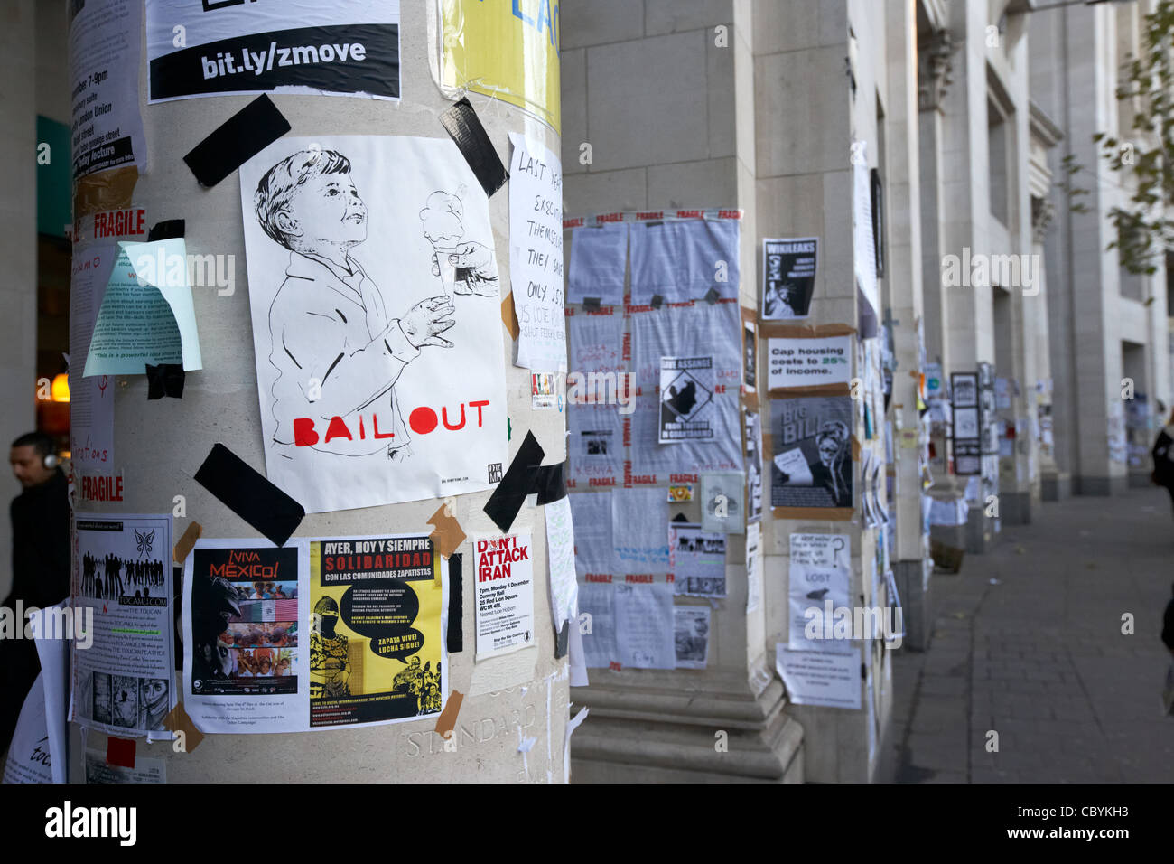 anti bankers bail out posters at the occupy london protest site in the city of London England UK United kingdom - Stock Image