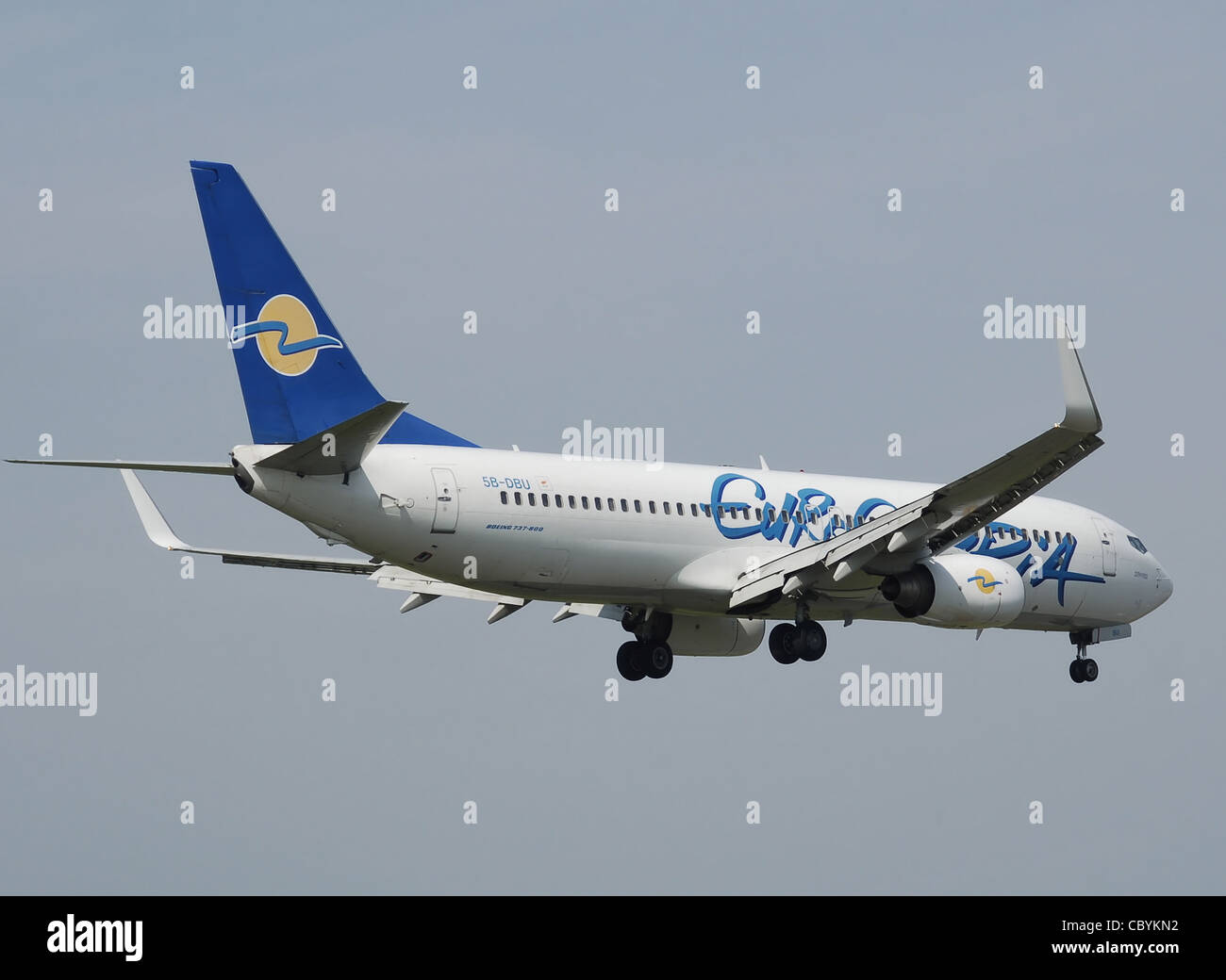 Eurocypria Boeing B737-800 (5B-DBU) lands at Birmingham International Airport, England. - Stock Image