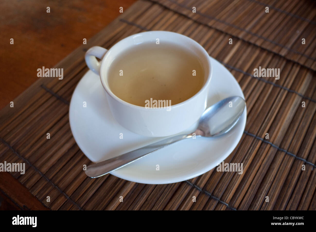 A cup of Laotian smoked green tea. - Stock Image