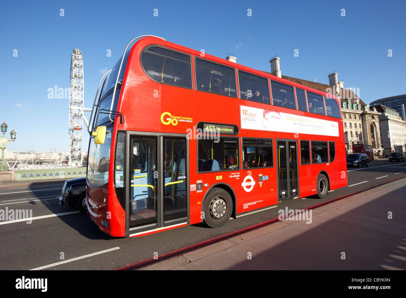 london red double decker bus public transport crossing westminster bridge england united kingdom uk - Stock Image