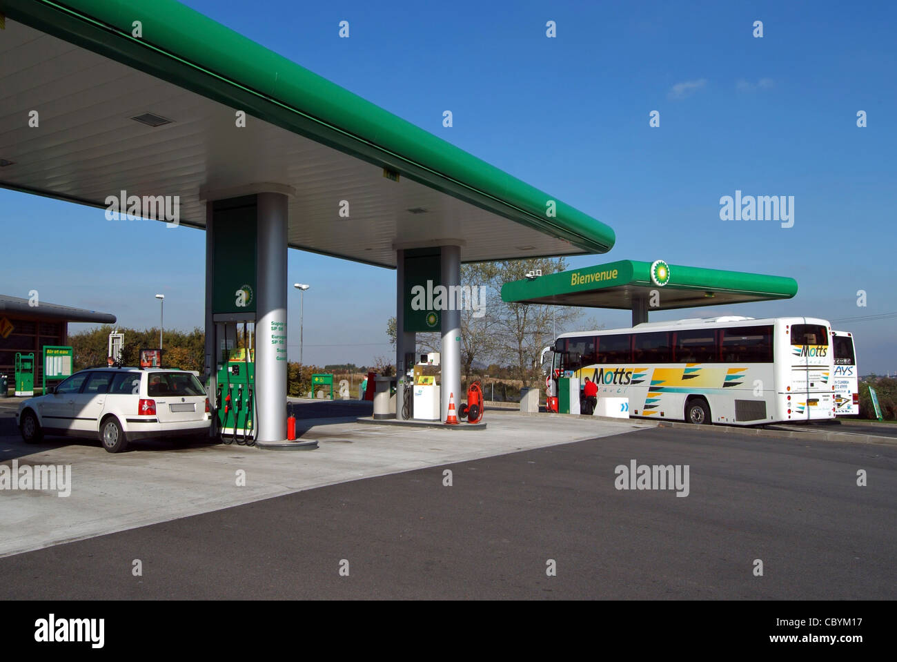 Diesel coach and petrol car refueling fill up at French BP motorway service station motorway between Paris and Calais - Stock Image