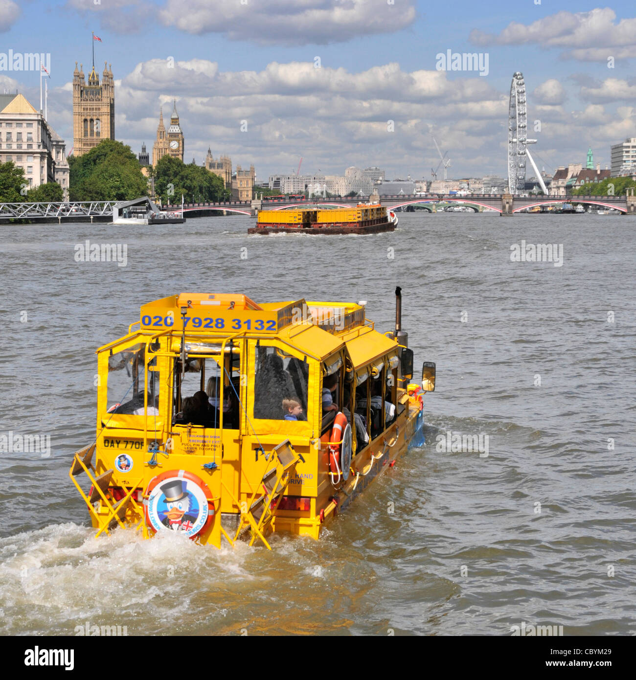 Duck Tours amphibious vehicle on River Thames sightseeing trip towards Westminster - Stock Image