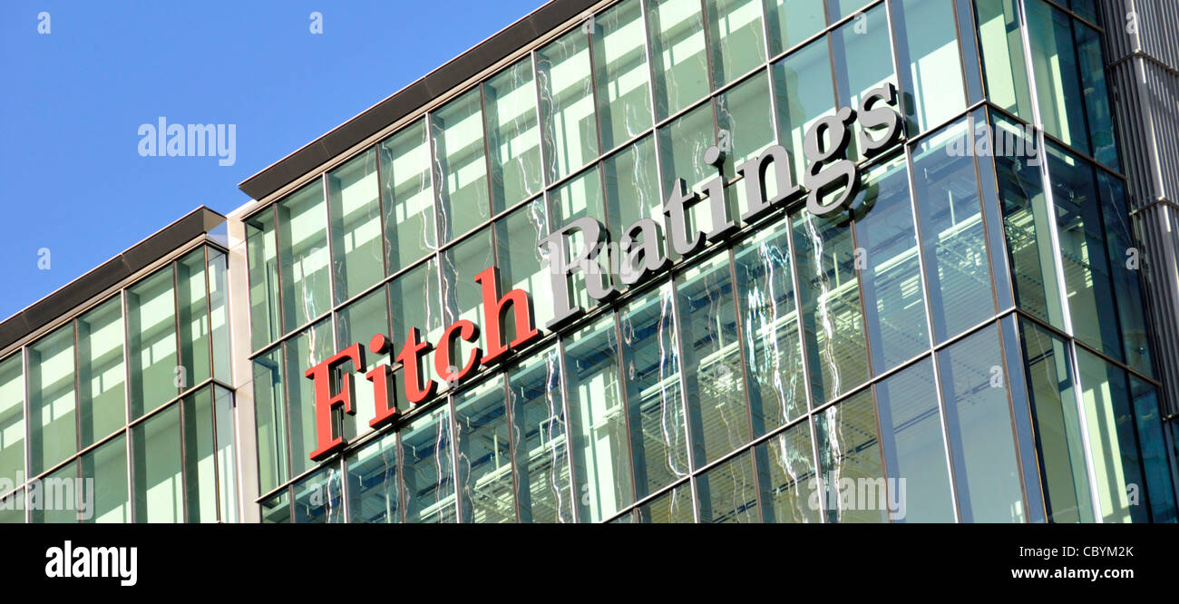 Credit rating agency & financial services company Fitch Ratings sign & logo on office building in London - Stock Image