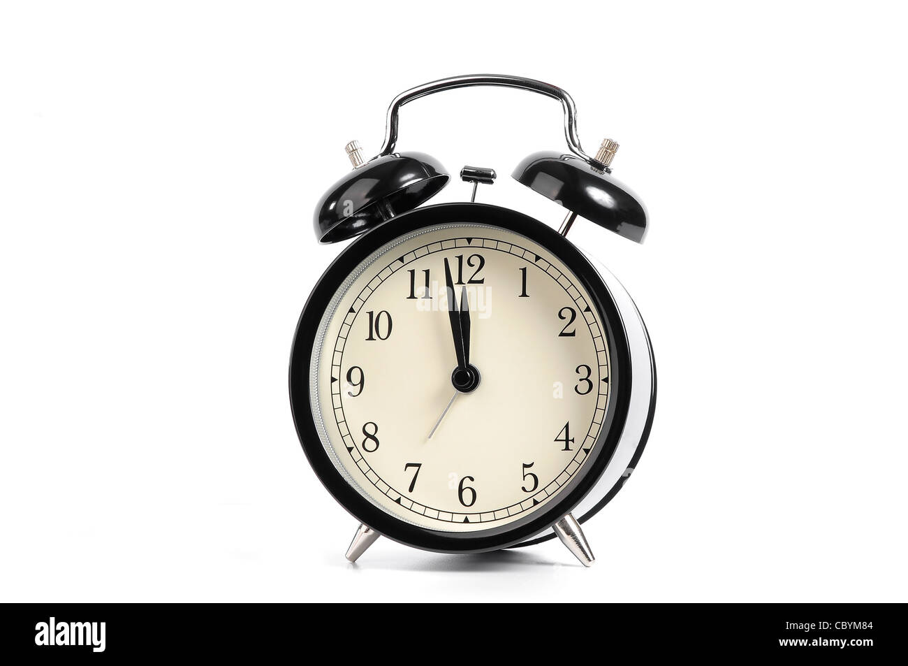 Old black alarm clock isolated on a white background - Stock Image