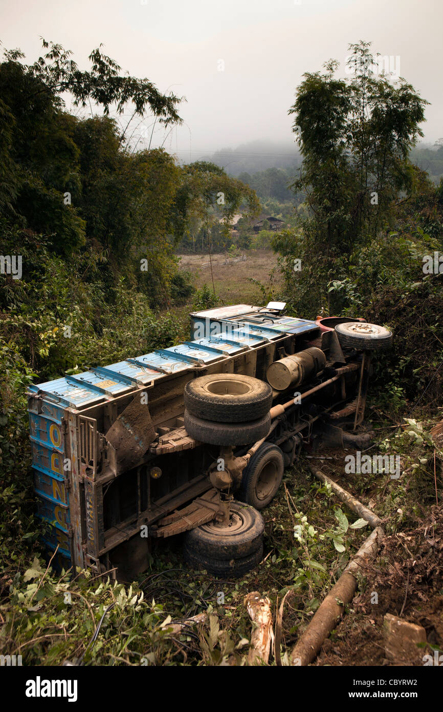 India, Arunachal Pradesh, Daporijo, dangerous roads, truck crash, lorry rolled into field off road - Stock Image