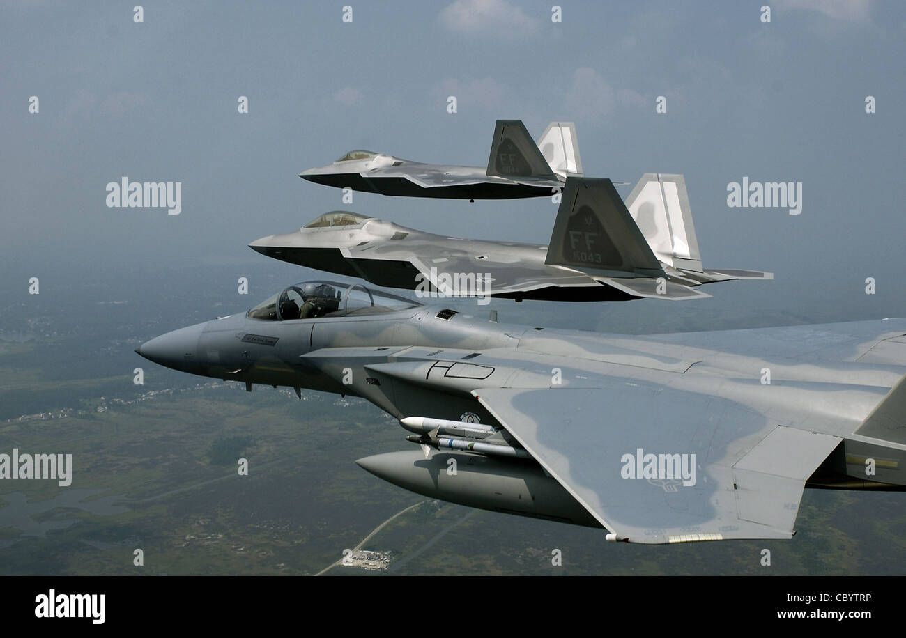 F-22 Raptors fly in formation. Defense Department officials are only partially funding the expansion of F-22 aircraft - Stock Image