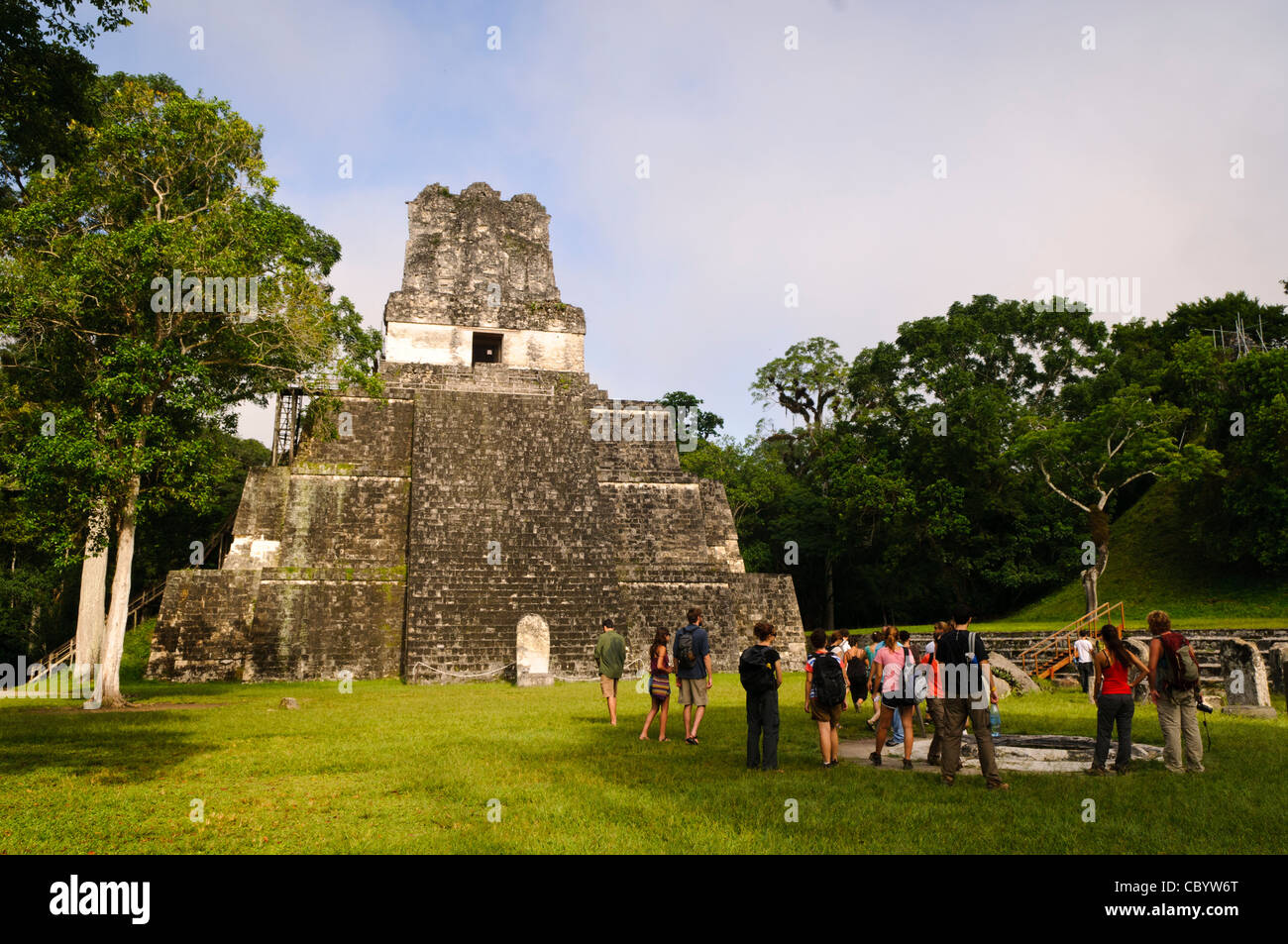 TIKAL, Guatemala - A group of tourists in the Main Plaza in front of the Temple of the Masks, or Temple 2, in the - Stock Image