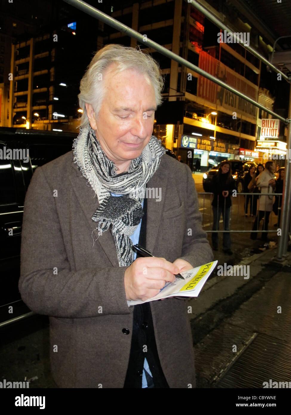 Actor Alan Rickman Signing an Autograph after a Broadway play - Stock Image