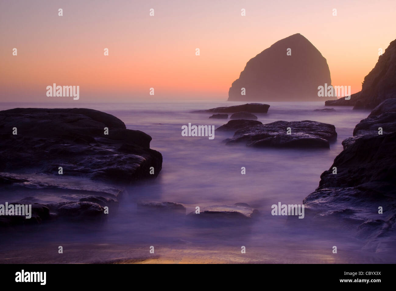 Oregon Beach Sunset with Waves in Motion Stock Photo
