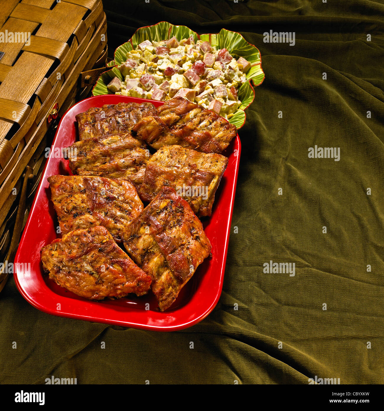 Country kitchen farm recipes, Dez's Puerto Rican potato salad, Greek spareribs  Meaat and vegetables. Stock Photo