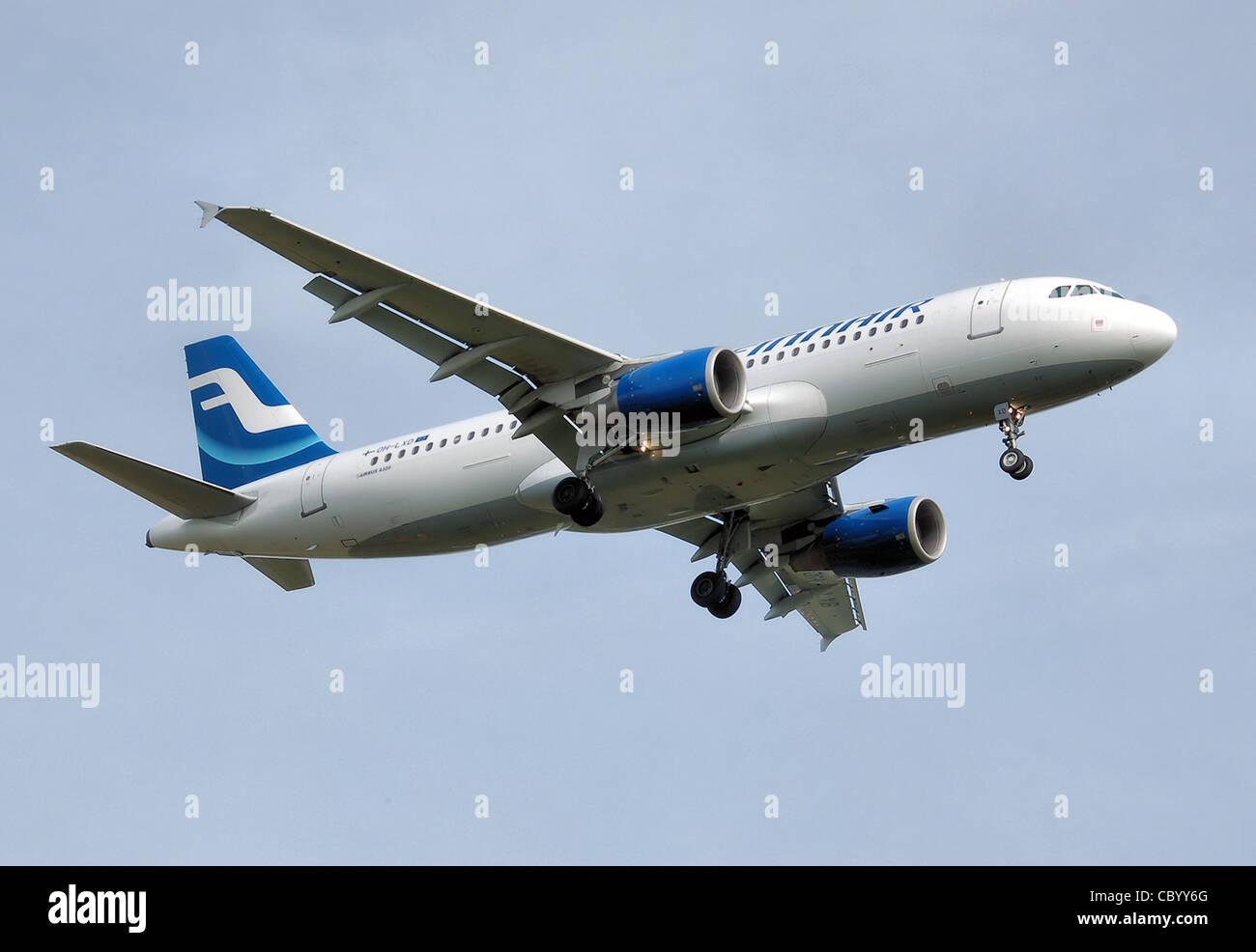 Finnair Airbus A320-200 (OH-LXD) lands at London Heathrow Airport, England. Stock Photo