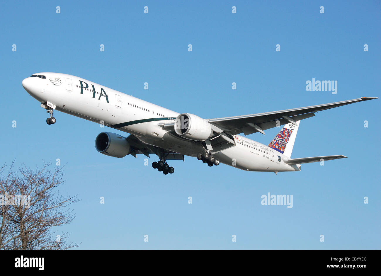 PIA Boeing 777-300ER (AP-BHW) lands at London Heathrow Airport, England. Stock Photo