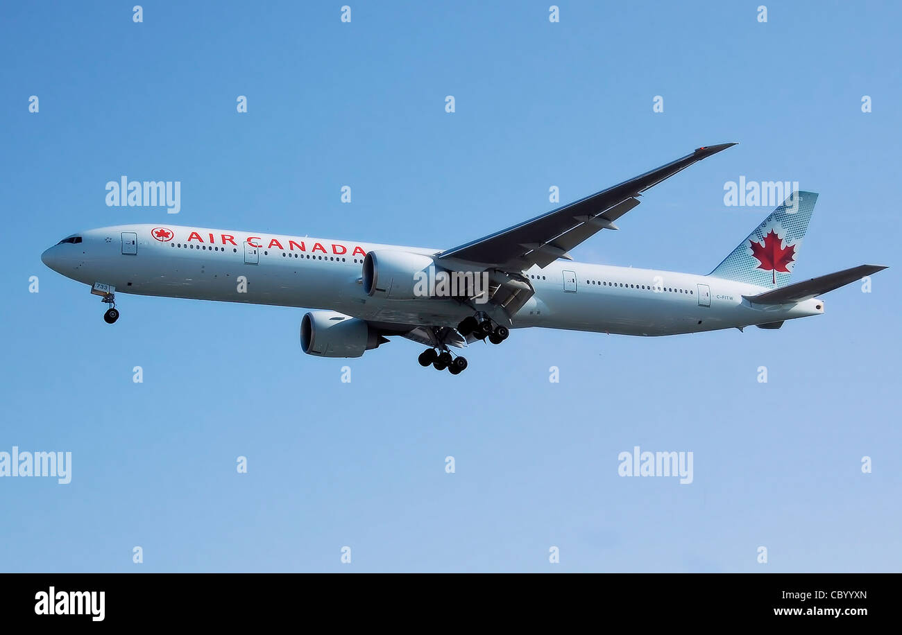 Air Canada Boeing 777-300ER (C-FITW) lands at London Heathrow Airport, England. - Stock Image