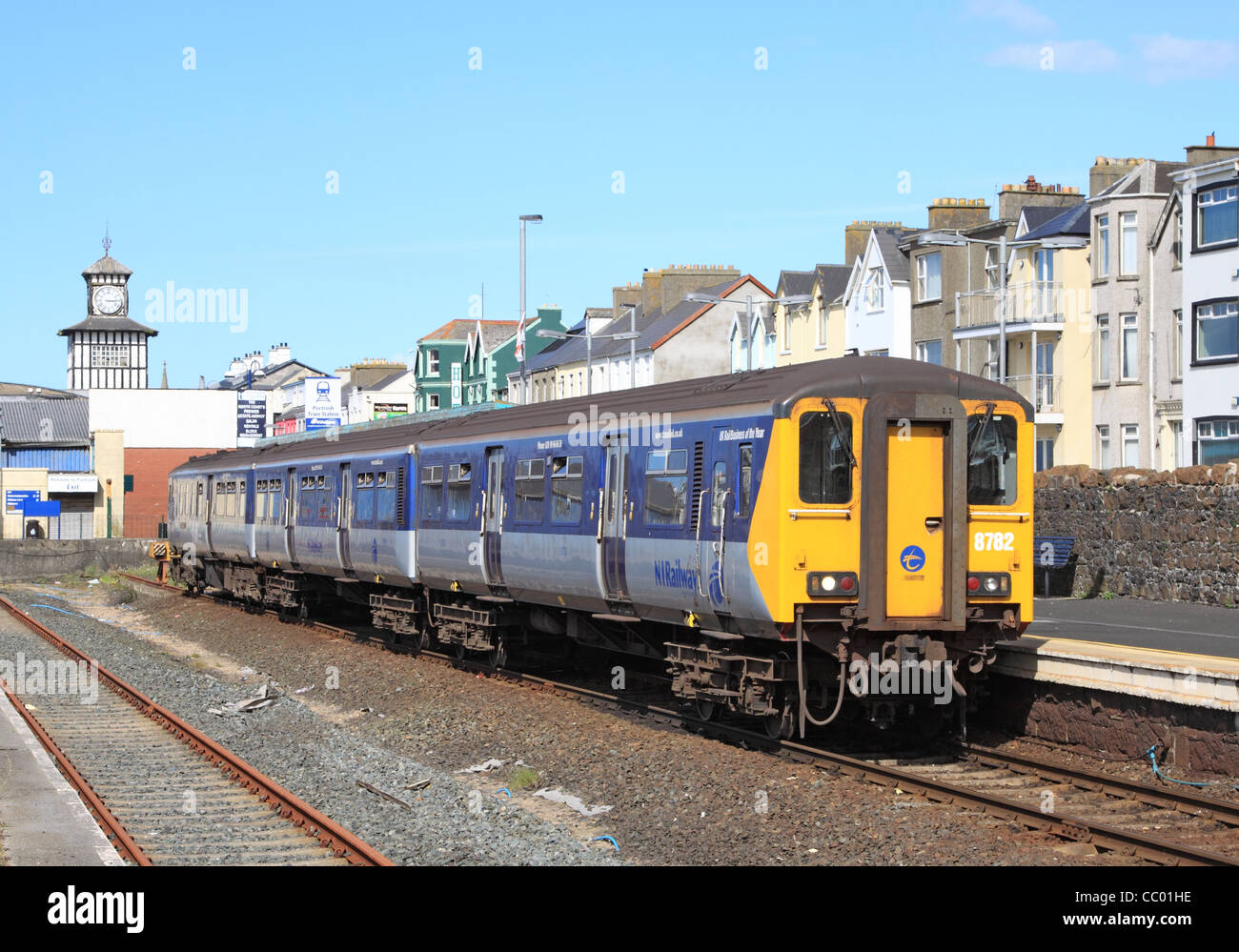 8782 waits to depart Portrush with the 1513 to Coleraine. The Driving Motor Brake Standard at the rear is 8452, - Stock Image