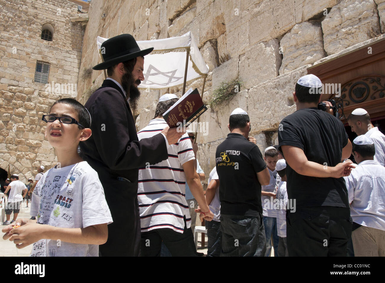 CELEBRATION OF A BAR MITSVA, JEWISH CEREMONY IN FRONT OF THE WAILING WALL (OR WESTERN WALL), OLD CITY OF JERUSALEM, - Stock Image