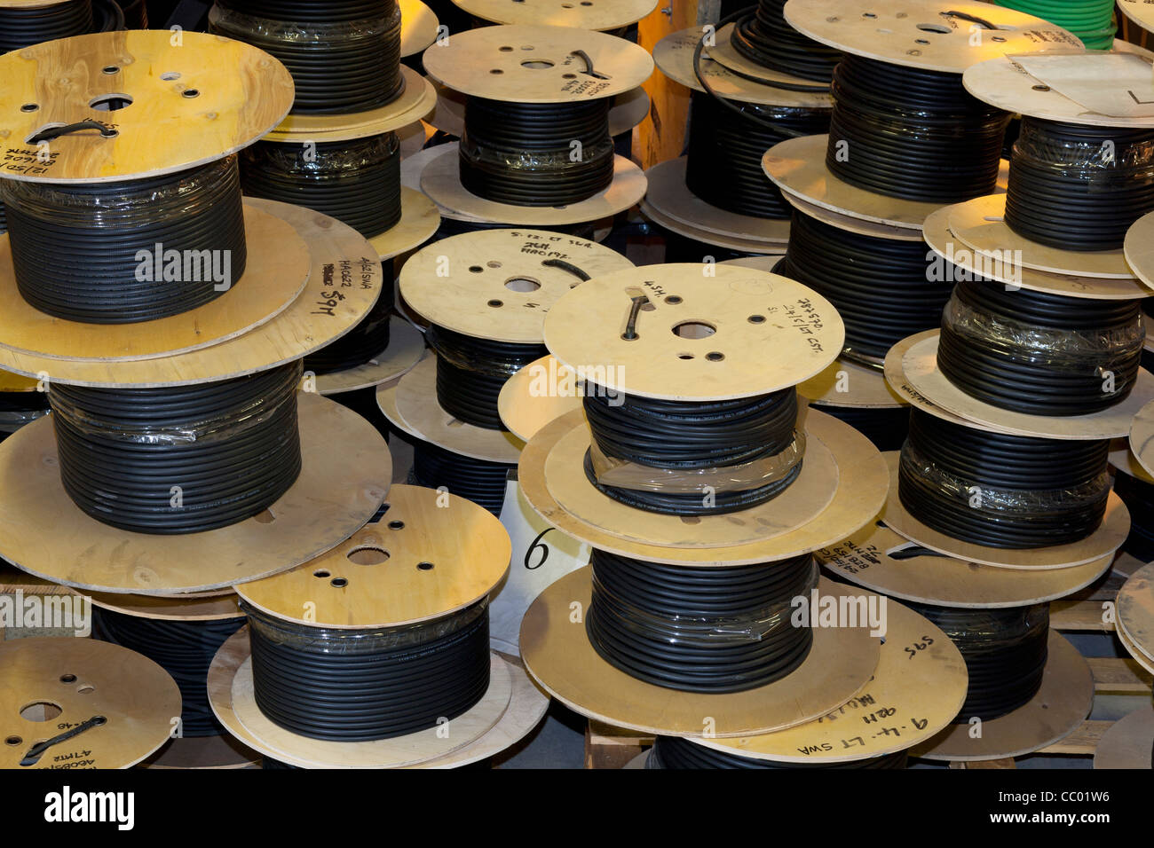 Small cable reels of fibre optic cable - Stock Image