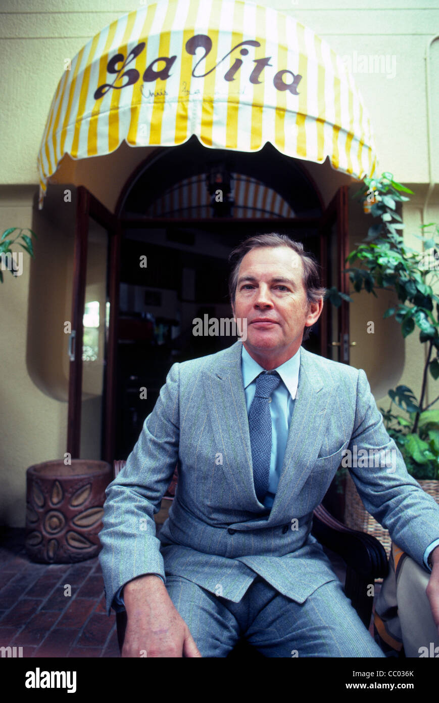 Dr. Christiaan Barnard, famous for doing the first heart transplant, poses at the Italian restaurant he owned later - Stock Image