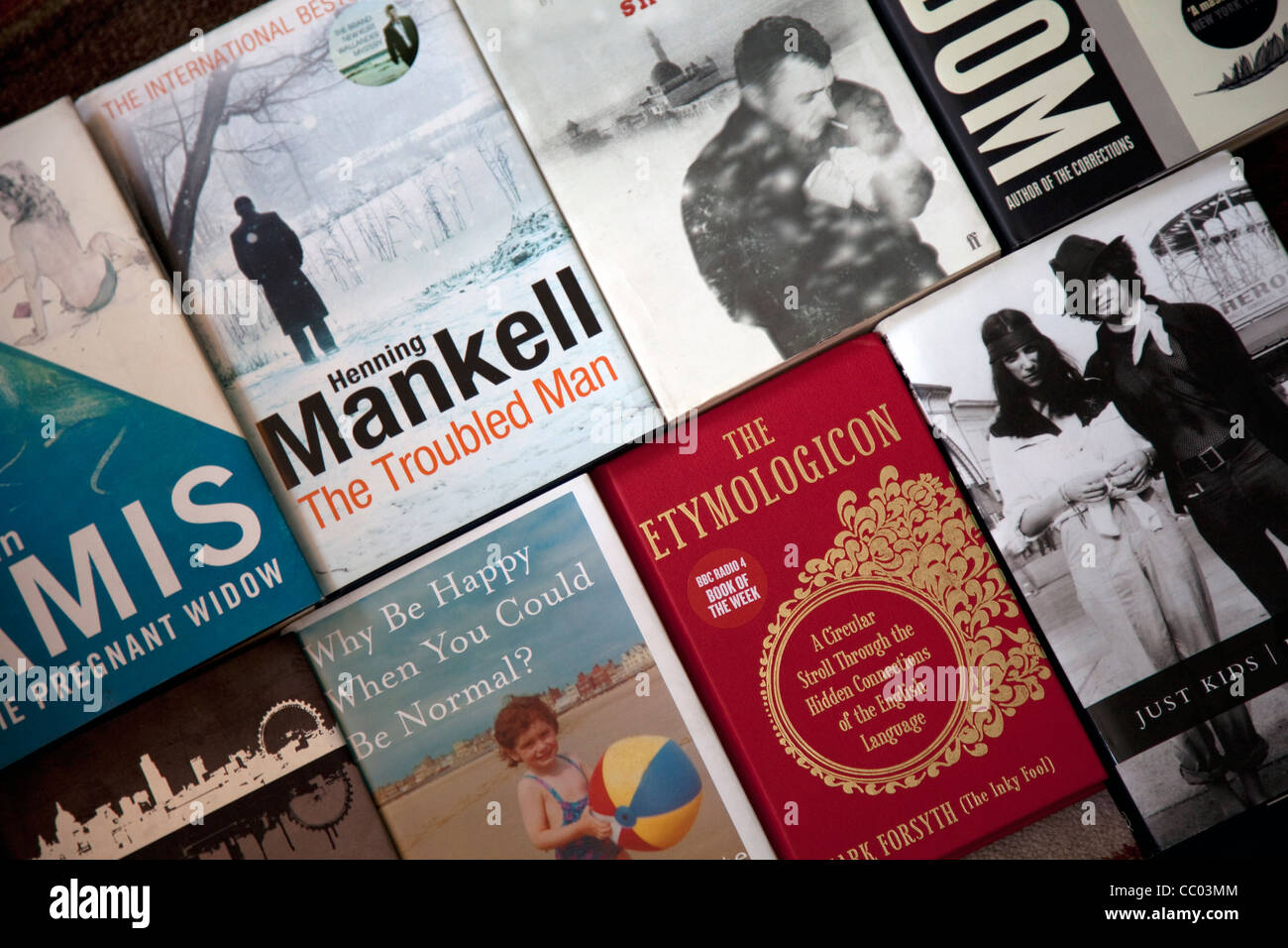 Physical book cover designs have become more important since the advent of e-books. - Stock Image