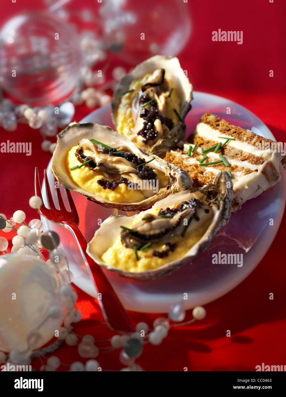 Scramble Eggs with Oysters and Caviar - Stock Image