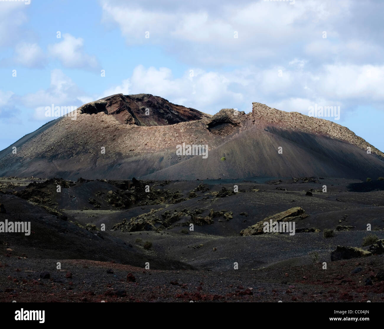 Volcano and lava flow on the Island of Lanzarote, Spain - Stock Image