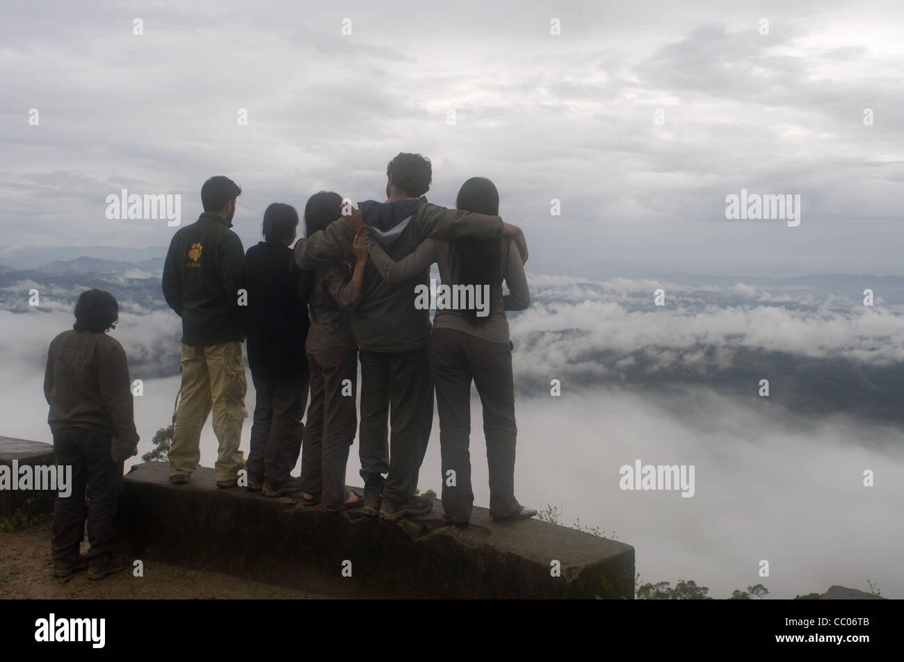 Friends staring at the Munnar valley - Stock Image