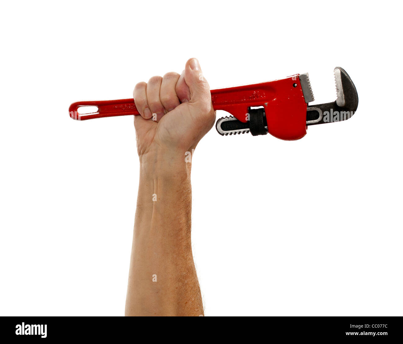 Man holding a large red wrench isolated against white - Stock Image