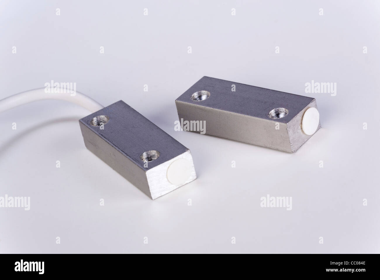 magnetic reed switch sensor and magnet - Stock Image